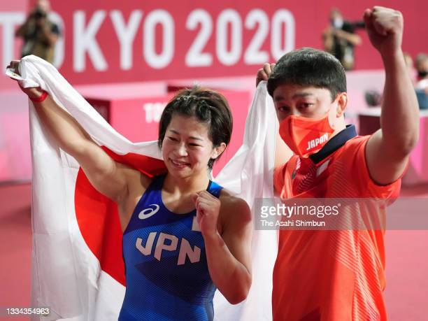 Mayu Mukaida of Team Japan celebrates with her fiance and coach Shota Shidochi after winning the gold medal following her victory in the Women's...