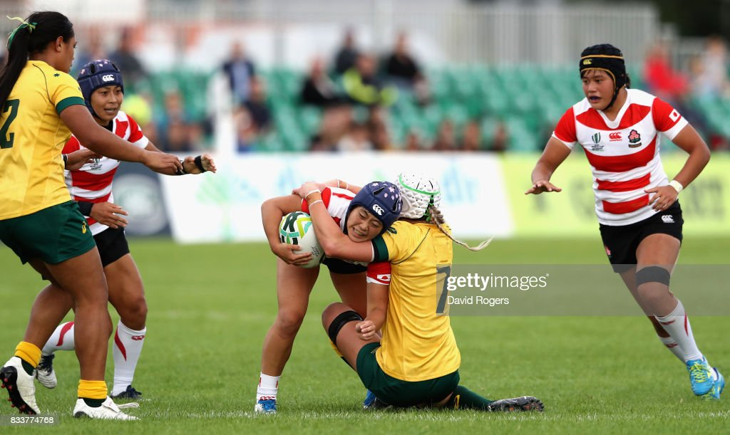 Mayu Shimizu of Japan is tackled by Chloe Butler of Australia during the Women's Rugby World Cup Pool C match between Australia and Japan at Billings Park UCD on August 17, 2017 in Dublin, Ireland.