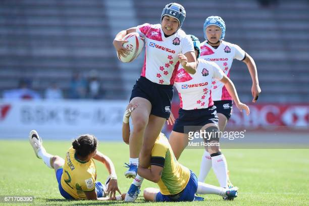 Mayu Shimizu of Japan is tackled during the HSBC World Rugby Women's Sevens Series 2016/17 Kitakyushu 11th place playoff between Brazil and Japan at...