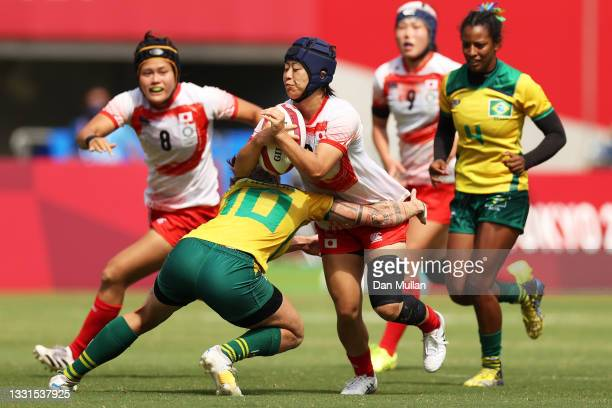 Mayu Shimizu of Team Japan is tackled in the Women's Placing 11-12 match between Team Brazil and Team Japan during the Rugby Sevens on day eight of...