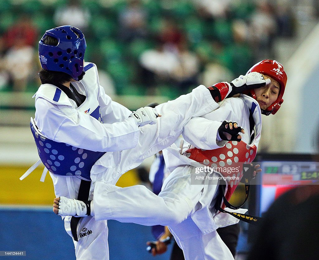 Mayu Yamada of Japan in action against Hou Yuzhuo of China during day two of the 20th Asian Taekwondo Championships at Phu Tho Stadium on May 10, 2012 in Ho Chi Minh City, Vietnam.