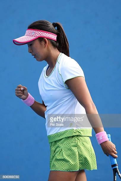 Mayuka Aikawa of Japan celebrates in her first round juniors match against Pranjala Yadlapalli of India during the Australian Open 2016 Junior...