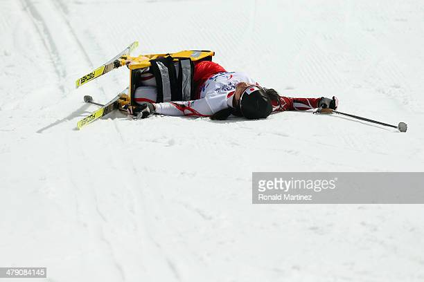 Mayuko Eno of Japan collapses after crossing the finish line in the Womens Cross Country 5km Sitting on day nine of the Sochi 2014 Paralympic Winter...