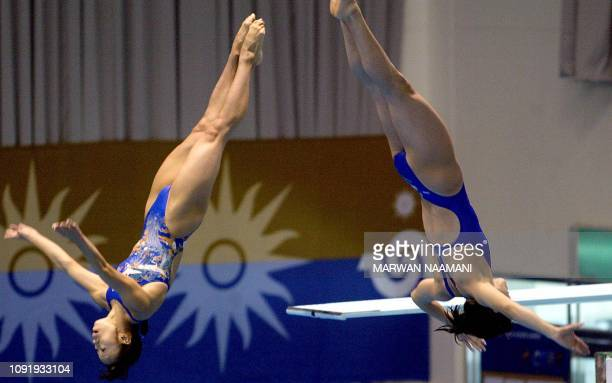 Mayumi Higuchi and Ryoko Nishii of Japan perform during the women's 3m sychronized diving final at Sajik pool in Busan 08 October 2002 during the...