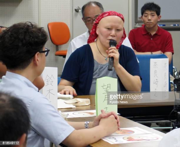 Mayumi Narazaki a 39yearold intellectually disabled woman presides over a gathering in Yokohama Kanagawa Prefecture on July 8 to discuss an incident...