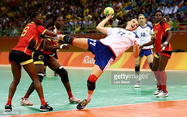 Mayya Petrova of Russia is challenged by Lurdes Marcelina Monteiro of Angola during the Womens Quarterfinal match between Russia and Angola on Day 11...