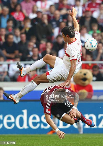 Maza of Stuttgart is challenged by Alexander Esswein of Nuernberg during the Bundesliga match between VfB Stuttgart and 1 FC Nuernberg at...
