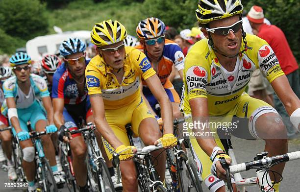 Spain's Iban Mayo rides in front of yellow jersey Denmark's Michael Rasmussen Russia's Denis Menchov USA's George Hincapie and Germany's Andreas...