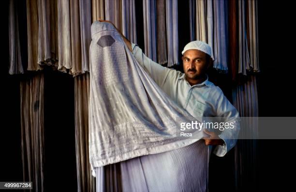 Mazar-e Sharif, Afghanistan. A burqa vendor in the city of Mazar-e-Sharif.