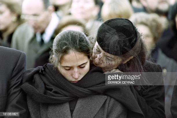 Mazarine Pingeot the late French President Francois Mitterrand's daughter is comforted by her mother Anne Pingeot during the burial ceremony in...