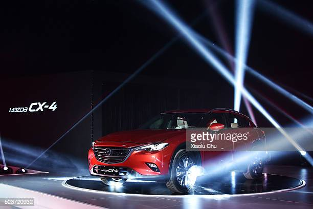 Mazda China introduces CX4 during the PreEvent For Beijing Motor Show Auto China on April 24 2016 in Beijing China Mazda China unveiled the CX4 a...