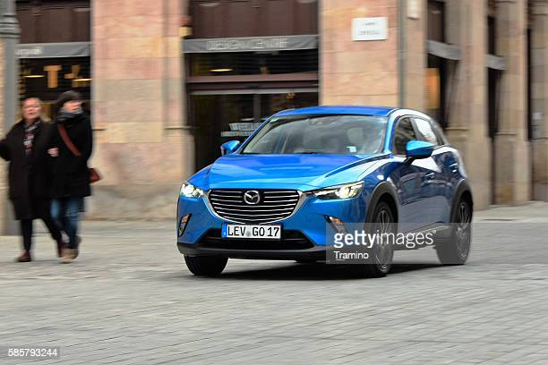 Mazda CX-3 driving on the street