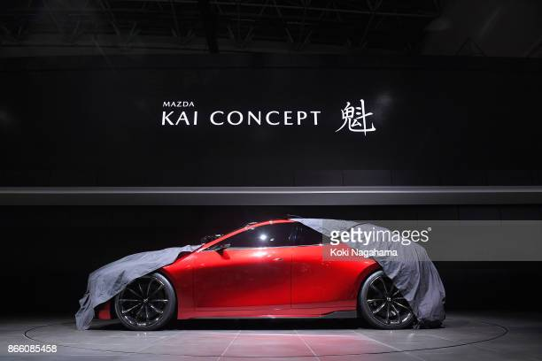 Mazda Kai Concept is unveiled by Mazda Motor Co CEO Masamichi Kogai at the Mazda Motor Co booth during the Tokyo Motor Show at Tokyo Big Sight on...