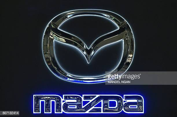 A Mazda logo is seen at the 2016 Washington Auto Show on January 27 2015 in Washington DC / AFP / Mandel Ngan