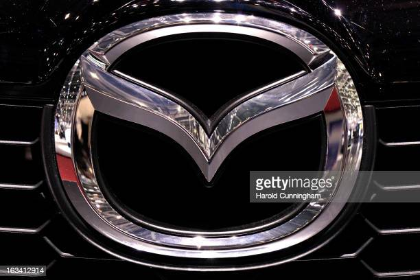 Mazda logo is seen during the 83rd Geneva Motor Show on March 5 2013 in Geneva Switzerland Held annually with more than 130 product premiers from the...