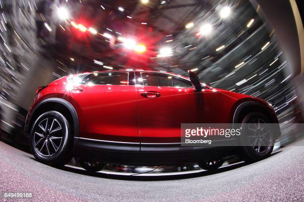 A Mazda Motor Corp CX5 compact sports utility vehicle stands on display on the second day of the 87th Geneva International Motor Show in Geneva...