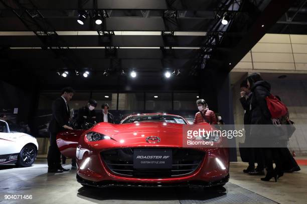 A Mazda Motor Corp Roadster RF custom vehicle stands on display at the Tokyo Auto Salon in Chiba Japan on Friday Jan 12 2018 The annual event at...