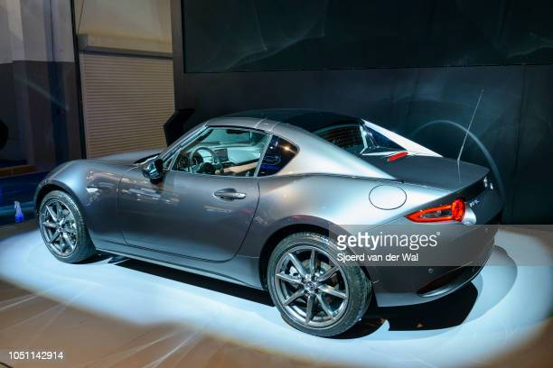 Mazda MX5 RF compact sportscar rear view on display at Brussels Expo on January 13 2017 in Brussels Belgium The MX5 or Miata in North America of the...