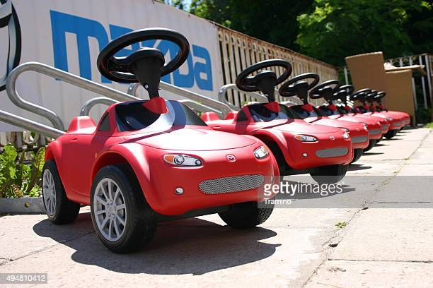 mazda mx-5 toy cars in a row - mazda mx 5 stock photos and pictures