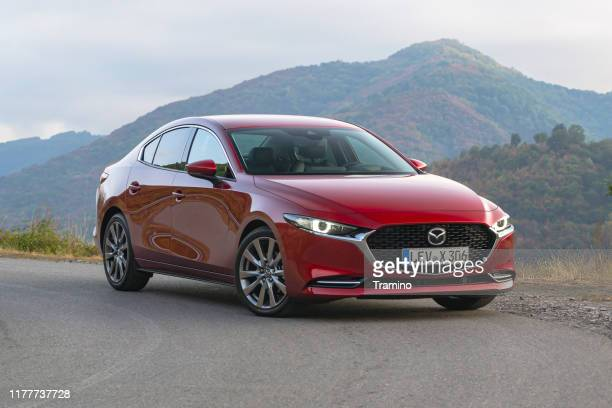 mazda3 sedan on the road - sedan stock pictures, royalty-free photos & images