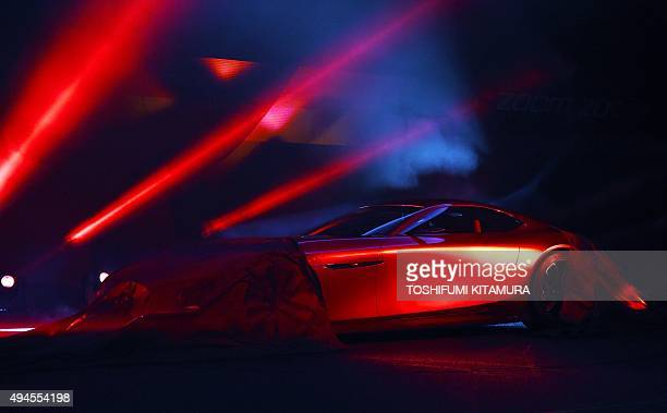 Mazda's new concept rotaryengine sports car 'RXVISION' is unveiled at the Tokyo Motor Show in Tokyo on October 28 2015 AFP PHOTO / TOSHIFUMI KITAMURA