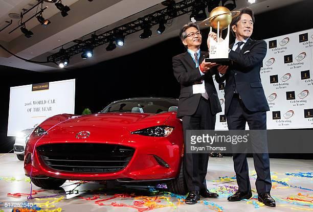 Mazda's Program Manager for the Mazda MX5 Nobuhiro Yamamoto and President of Mazda North American Operations Masahiro Moro accept the 2016 World Car...
