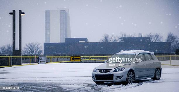 Mazdaspeed 3 on the top level of a parking garage during a snowstorm in Tulsa, Oklahoma.