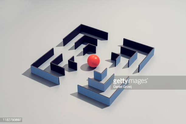 maze structure with a red sphere in the center