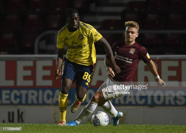 Mazeed Ogungbo of Arsenal takes on Sam Hoskins of Northampton during the Leasingcom match between Northampton Town and Arsenal U21 at PTS Academy...