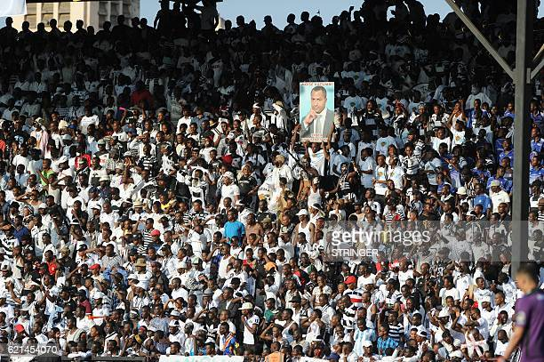 TP Mazembe supporters hold a portrait of the team owner Moise Katumbi during the second leg of the CAF Confederation Cup final against the MO Bejaja...