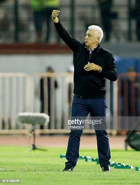 Mazembe's coach Hubert Velud looks at his players during the CAF Confederation cup final Algerian Mouloudia Bejaia against Congolese TP Mazembe on...