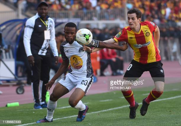 Mazembe's forward Meschak Elia fights for a ball with Esperance's midfielder Ayman Ben Mohamed during the first leg of the CAF champions league semi...