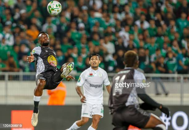 Mazembe's midfielder Miche Mika clears the ball during the first leg of the CAF Champions League Quarter-final football match between Morocco's Raja...