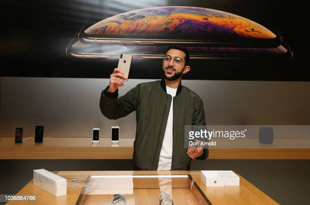 Crowds wait in anticipation for the Australian release of the latest iPhone models at Apple Store on September 21 2018 in Sydney Australia Apple's...