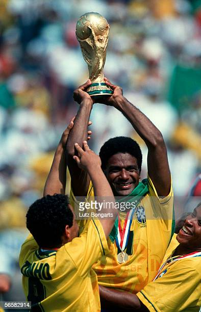 Mazinho of Brazil celebrates with the trophy after winning the World Cup final match between Brazil and Italy on July 17 1994 in Los Angeles USA