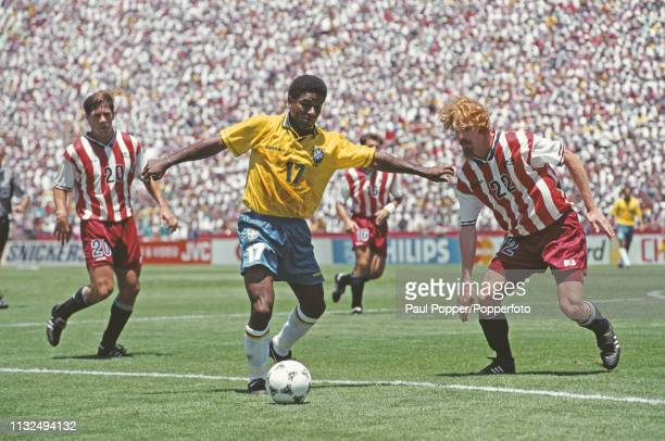 Mazinho of Brazil pictured with the ball as Alexi Lalas and Paul Caligiuri move in during play between Brazil and United States in their 1994 FIFA...