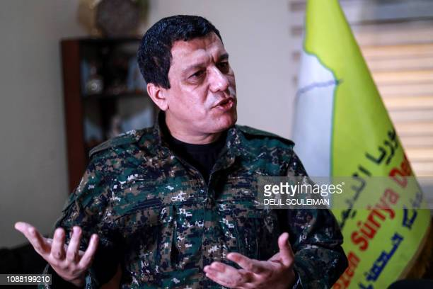 Mazloum Abdi , commander-in-chief of the Syrian Democratic Forces , speaks with AFP during an interview in the countryside outside the northwestern...