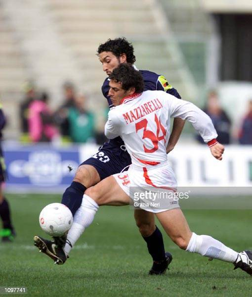 Mazzarelli of Bari and Zambrotta of Juventus in action during the SERIE A 19th Round League match between Bari and Juventus, played at the San Nicola...