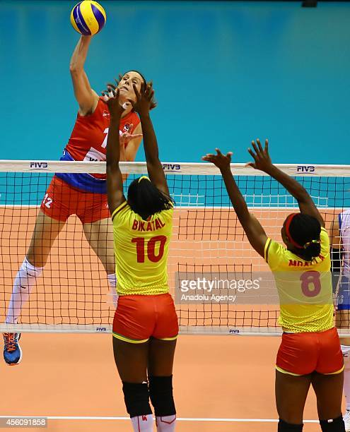Mballa and Bikatal of Cameroon in action against Jelena Nikolic of Serbia during the 2014 FIVB Volleyball Women's World Championship Group B...