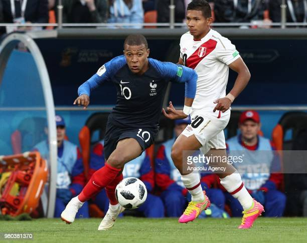 Mbappe of France in action against Edison Flores of Peru during the 2018 FIFA World Cup Russia Group C match between France and Peru at the...