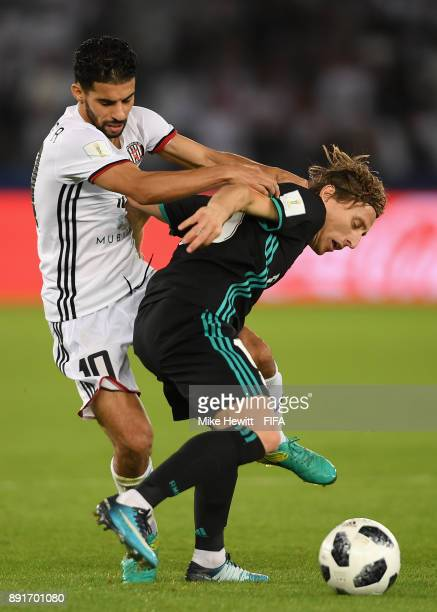 Mbark Boussoufa of Al Jazira and Luka Modric of Real Madrid battle for possesion during the FIFA Club World Cup UAE 2017 semifinal match between Al...