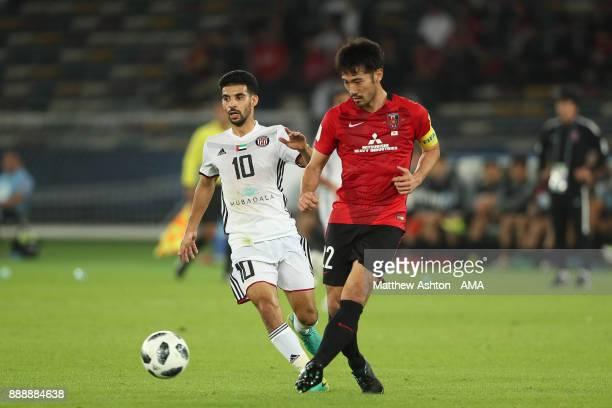 Mbark Boussoufa of Al Jazira competes with Yuki Abe of Urawa Red Diamonds during the FIFA Club World Cup UAE 2017 match between Al Jazira and Urawa...