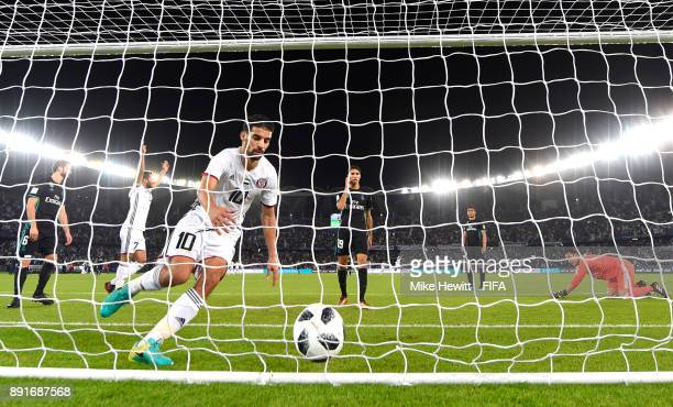 Mbark Boussoufa of Al Jazira grabs the ball to celebrate his sides first goal during the FIFA Club World Cup UAE 2017 semifinal match between Al...