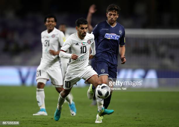 Mbark Boussoufa of AlJazira is challenged by Darren White of Auckland City FC during the FIFA Club World Cup UAE 2017 play off match between Al...