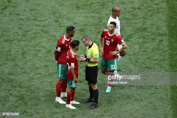Mbark Boussoufa of Morocco argues with Referee Mark Geiger during the 2018 FIFA World Cup Russia group B match between Portugal and Morocco at...