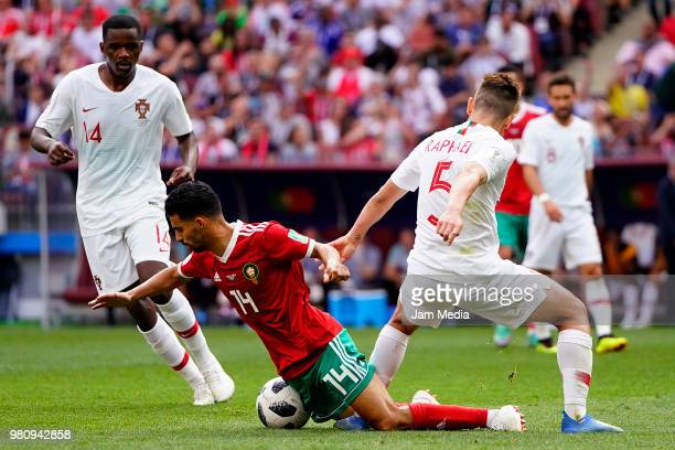 Mbark Boussoufa of Morocco fights for the ball with Raphael Guerreiro of Portugal during the 2018 FIFA World Cup Russia group B match between...