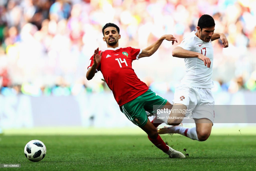 Mbark Boussoufa of Morocco gets past the tackle from Goncalo Guedes of Portugal during the 2018 FIFA World Cup Russia group B match between Portugal and Morocco at Luzhniki Stadium on June 20, 2018 in Moscow, Russia.