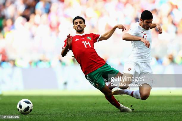 Mbark Boussoufa of Morocco gets past the tackle from Goncalo Guedes of Portugal during the 2018 FIFA World Cup Russia group B match between Portugal...