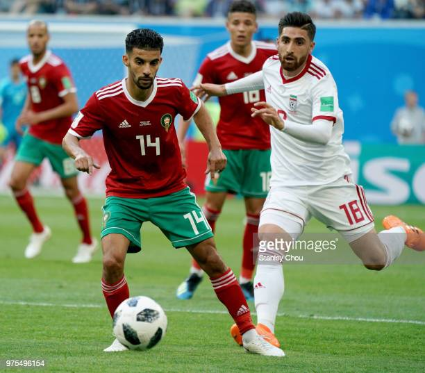Mbark Boussoufa of Morocco pulls off Alireza Jahanbakhsh of Iran during the 2018 FIFA World Cup Russia group B match between Morocco and Iran at...