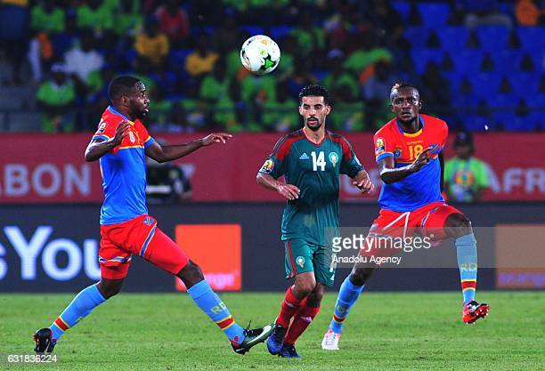 Mbark Boussoufa of Morocco vies for the ball against Cedric Bakambu and Merveille Bokadi of DR Congo during the African Cup of Nations 2017 Group C...